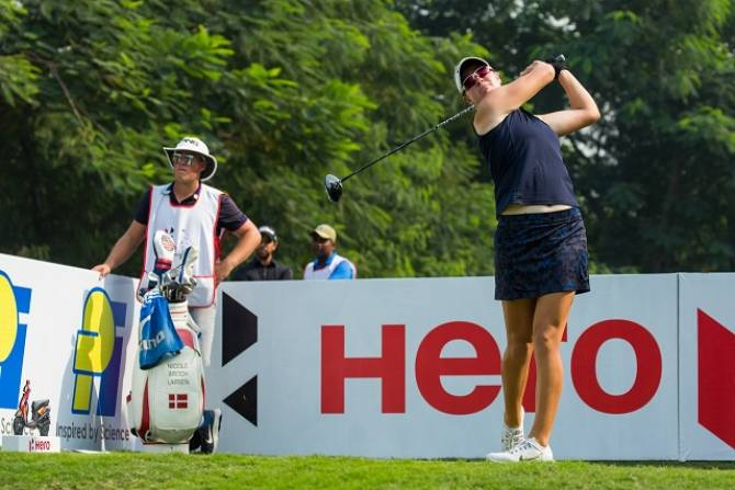 Women sport news - Three share lead after Wolf has a howler